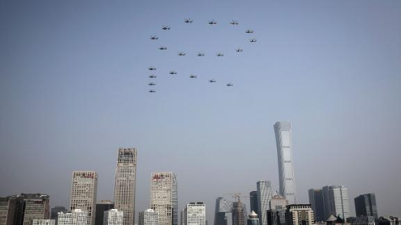 Planes from the Chinese People's Liberation Army air force fly in formation as part of the 70th anniversary celebration in Beijing.