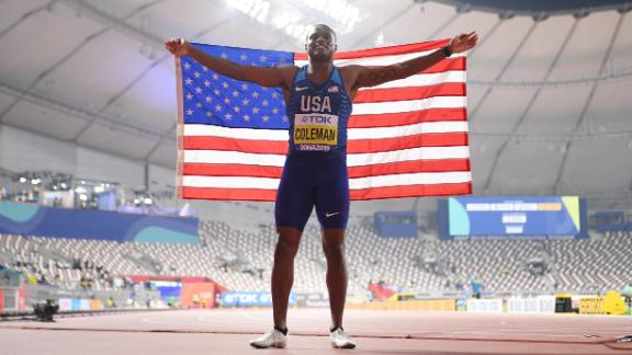 Christian Coleman celebrates winning gold in the men's 100 meters, traditionally the blue riband event. But there were vast swathes of empty seats.