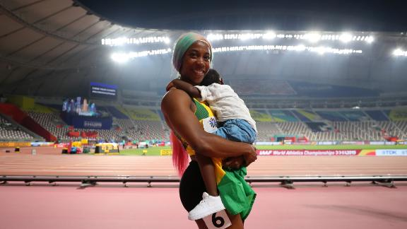 Shelly-Ann Fraser-Pryce celebrates with her son Zyon after winning the women's 100 meters final, but the empty stands have caused controversy.
