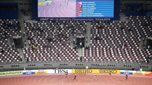 Spectators spread out to watch the heats of the women's 400 meters.