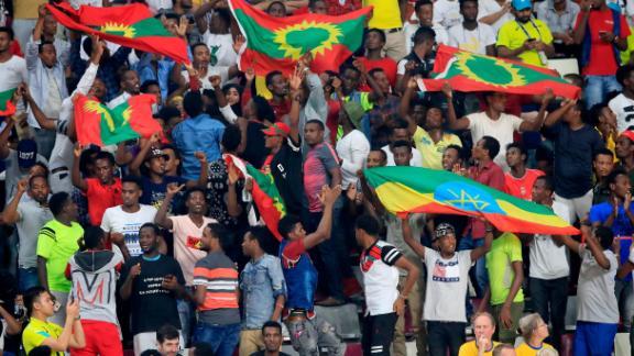 Ethiopian fans cheer on their athletes in the Khalifa International Stadium.