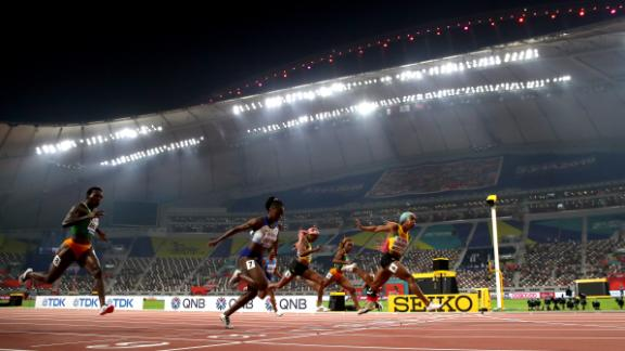 Fraser-Pryce crosses the finish line to win the women's 100 meters final ahead of Dina Asher-Smith. Huge cloths were spread out on the upper tiers of the Khalifa Stadium to mask the empty spaces.