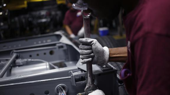A worker uses a wrench to install components on a semi-trailer bogie at the Wabash National Corp. manufacturing facility in Lafayette, Indiana, U.S., on Tuesday, Aug. 13, 2019. Markit is scheduled to release manufacturing figures on August 22. Photographer: Luke Sharrett/Bloomberg via Getty Images