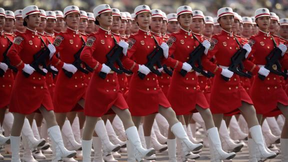 Chinese female militia members march in formation.