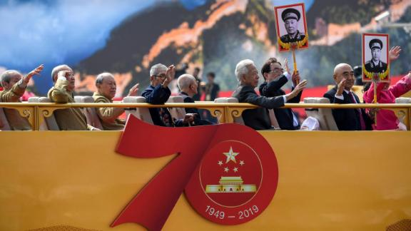 Veterans and relatives of revolutionary martyrs take part in the National Day parade in Tiananmen Square.