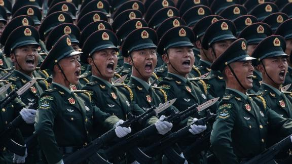 Chinese soldiers shout as they march in formation during the 70th anniversary parade.
