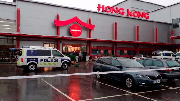 Police attend the scene of a violent incident at the complex in Kuopio, eastern Finland, on October 1.