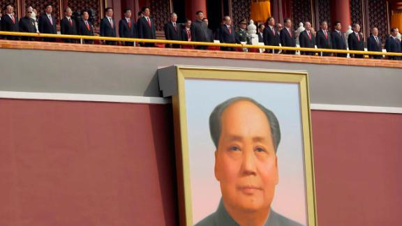 Chinese leaders including President Xi Jinping, center, stand on Tiananmen Gate above the large portrait of the late Chinese leader Mao Zedong.
