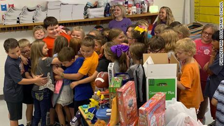 Third-graders surprise classmate with toy drive after he lost all his belongings in a house fire.
