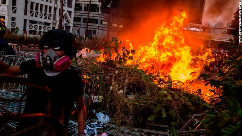 """A fire lit by protesters burn in the Sha Tin district of Hong Kong on October 1, 2019, as violent demonstrations take place in the streets of the city on the National Day holiday to mark the 70th anniversary of communist China's founding. - Strife-torn Hong Kong on October 1 marked the 70th anniversary of communist China's founding with defiant """"Day of Grief"""" protests and fresh clashes with police as pro-democracy activists ignored a ban and took to the streets across the city. (Photo by ISAAC LAWRENCE / AFP)        (Photo credit should read ISAAC LAWRENCE/AFP/Getty Images)"""
