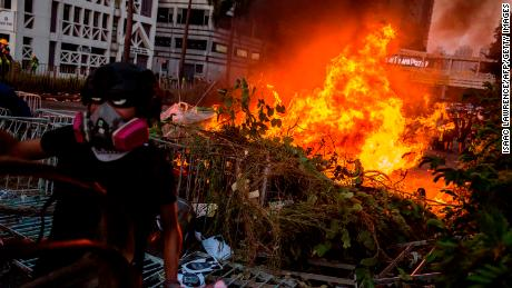 A fire lit by protesters burns in the Sha Tin district of Hong Kong.