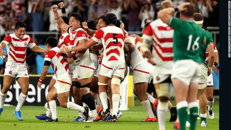 Japanese players celebrate their victory over Ireland at Shizuoka Stadium Ecopa on September 28.