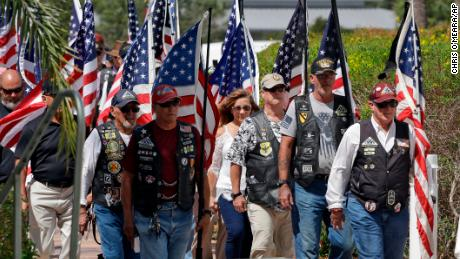 A motorcycle group takes part in funeral for Army veteran Edward K. Pearson.