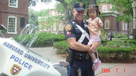 Crystal Wang was 3 years old when her father snapped a picture of her in the arms of Marren.