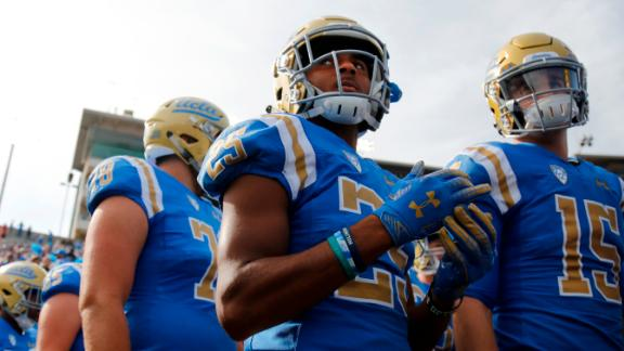 PASADENA, CALIFORNIA - NOVEMBER 17:  Wide receiver Antonio Brown #25 of the UCLA Bruins  waits with teammates to take the field during the first half of a football game at Rose Bowl on November 17, 2018 in Pasadena, California. (Photo by Katharine Lotze/Getty Images)