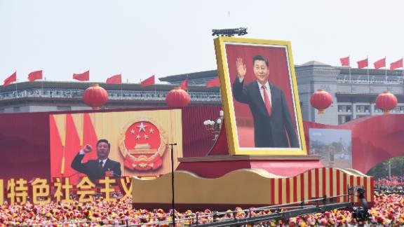 A float with a giant portrait of Chinese President Xi Jinping passes by Tiananmen Square during the National Day parade in Tiananmen Square in Beijing on October 1, 2019, to mark the 70th anniversary of the founding of the Peoples Republic of China. (Photo by GREG BAKER / AFP)        (Photo credit should read GREG BAKER/AFP/Getty Images)