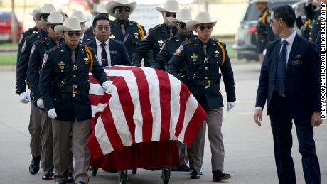 An honor guard escorts the casket of Harris County Sheriff's Deputy Sandeep Dhaliwal for his funeral at Berry Center on Wednesday, Oct. 2, 2019, in Cypress, Texas. Dhaliwal was killed in the line of duty Friday, when he was shot and killed during a traffic stop. (Brett Coomer/Houston Chronicle via AP)