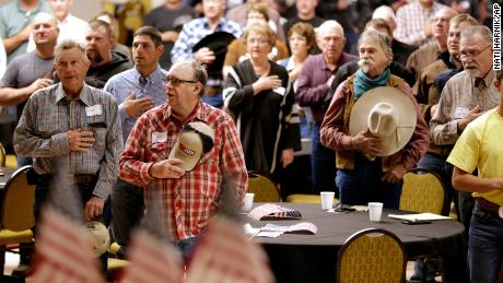 The pledge of allegiance is presented in Omaha, Nebraska, beginning of a meeting to urge President Trump to ensure fair prices for ranchers and ranchers.
