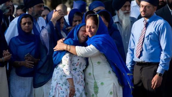 Relatives of Dhaliwal and other mourners arrive at Berry Center for Wednesday