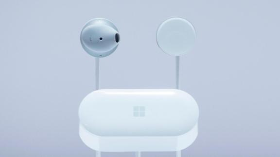 Microsoft Surface Earbuds and a case are displayed, Wednesday, Oct. 2, 2019, in New York. (AP Photo/Mark Lennihan)