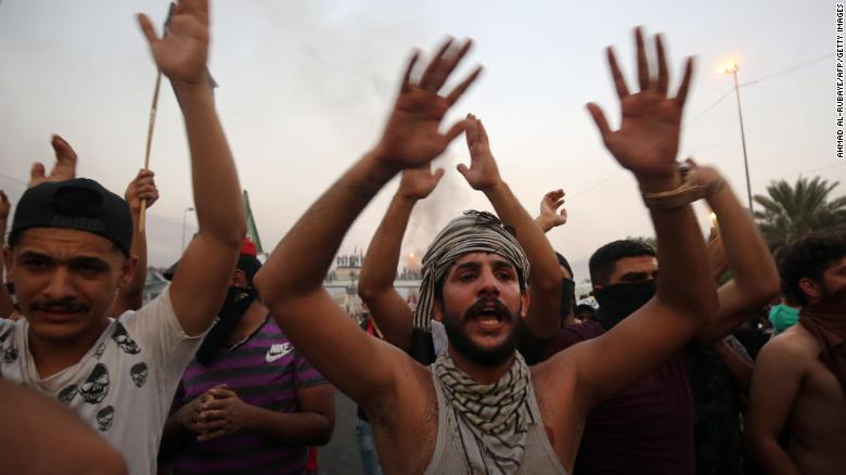 Iraqi protesters chant during a demonstration against state corruption, failing public services and unemployment in Baghdad on October 2, 2019.