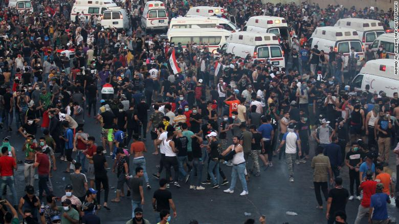 "Iraqi protesters gather during a demonstration against state corruption, failing public services and unemployment at Tayaran square in Baghdad on October 2, 2019. - Iraq's president and the United Nations urged security forces to show restraint after two protesters were killed in clashes with police that other top officials blamed on ""infiltrators."" (Photo by AHMAD AL-RUBAYE / AFP) (Photo by AHMAD AL-RUBAYE/AFP via Getty Images)"