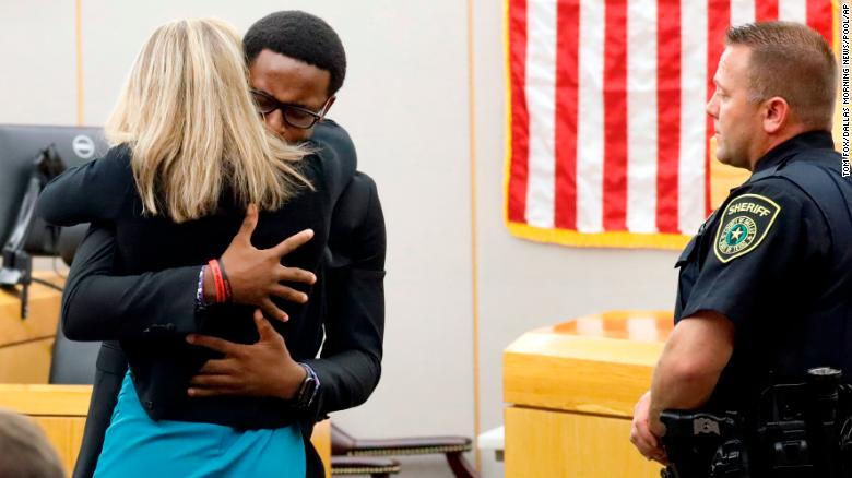 Botham Jean's younger brother Brandt Jean hugs convicted murderer and former Dallas Police Officer Amber Guyger.
