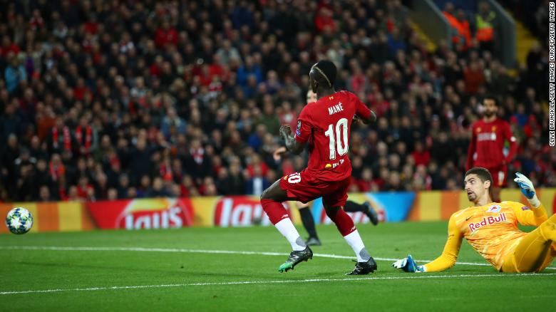Sadio Mane of Liverpool opens the scoring at Anfield.