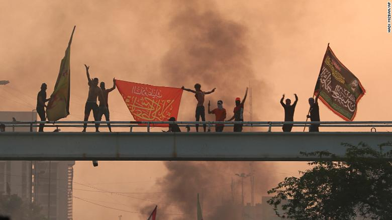 Demonstrators chant slogans during a protest in the Iraqi capital on October 2.