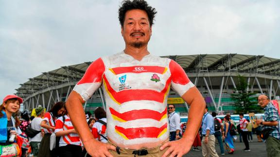 A Japan fan has the national team's jersey painted on as he arrives for the Japan 2019 Rugby World Cup Pool A match between Japan and Ireland at the Shizuoka Stadium Ecopa in Shizuoka on September 28, 2019. (Photo by William WEST / AFP)        (Photo credit should read WILLIAM WEST/AFP/Getty Images)