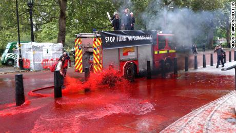 Climate activists spray UK finance ministry with fake blood