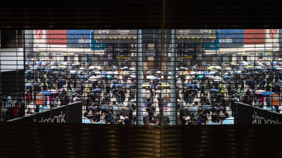 Demonstrators march outside a closed shopping mall during a protest at Causeway Bay district in Hong Kong, China, on Sunday, Sept. 29, 2019. Hong Kong police used a water cannon, rubber bullets and tear gas on protesters who set a train station entrance on fire and hurled petrol bombs as they tried to march on the government offices in the city center. Photographer: Kyle Lam/Bloomberg via Getty Images