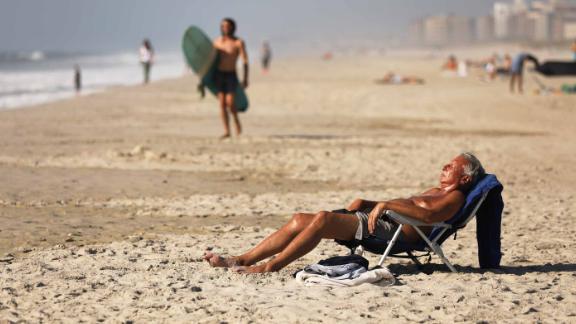 People enjoy the unseasonably warm weather in New York last month.