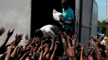 Food and school supplies are delivered to a Port-au-Prince neighborhood