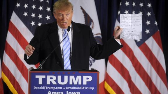 In this January 2016 file photo, U.S. Republican presidential candidate Donald Trump shows a sheet with poll numbers as he speaks at a rally at Iowa State University in Ames, Iowa.
