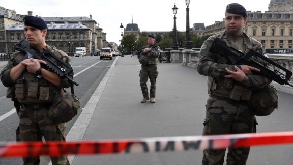 French soldiers stand guard near Paris prefecture de police (police headquarters) on October 3, 2019 after four officers were killed in a knife attack. - A man wielding a knife stabbed and killed four officers at the police headquarters in the heart of central Paris on Thursday, before being shot dead. (Photo by Bertrand GUAY / AFP) (Photo by BERTRAND GUAY/AFP via Getty Images)