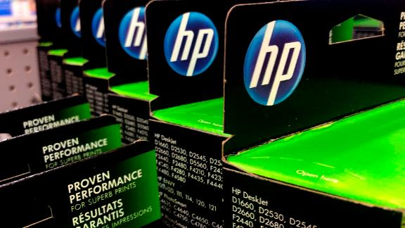 This Aug. 15, 2019, photo shows the HP logo on Hewlett-Packard printer ink cartridges at a store in Manchester, N.H.  Hewlett-Packard  reports financial results Thursday, Aug. 22. (AP Photo/Charles Krupa)