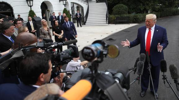 Counselor to the President Kellyanne Conway, Press Secretary Stephanie Grisham, and Deputy Press Secretary Hogan Gidley listen as U.S. President Donald Trump answers questions while departing the White House on October 03, 2019 in Washington, DC.