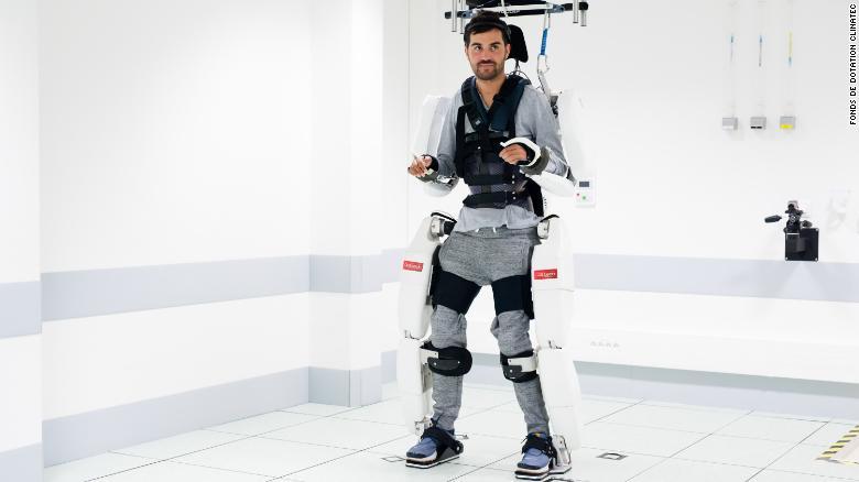 Paralyzed man walks using brain-controlled robotic suit
