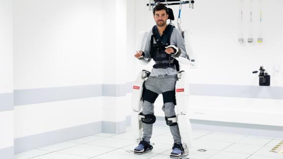 Paralyzed man moves using mind reading robotic suit