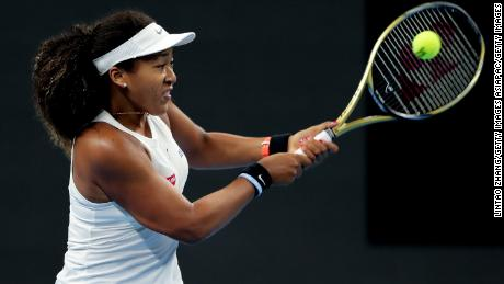 Naomi Osaka returns a shot against Bianca Andreescu of Canada in Beijing.