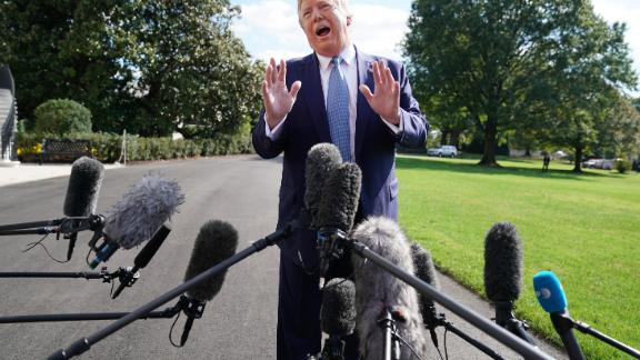 WASHINGTON, DC - OCTOBER 04: U.S. President Donald Trump talks to journalists on the South Lawn of the White House before boarding Marine One and traveling to Walter Reed National Military Medical Center October 04, 2019 in Washington, DC. According to the White House, Trump will be visiting injured military service members. (Photo by Chip Somodevilla/Getty Images)