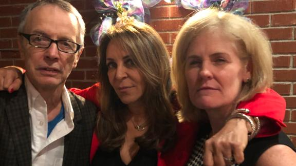 Klapper, center, is pictured with Romedio Viola (left) and analyst Sharon Garvey (right). The El Dorado team still keeps in touch.