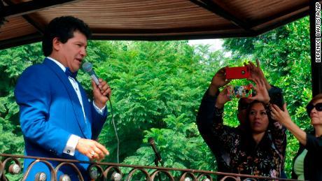 Jose Alejandro Ordonez, a professional impersonator of the legendary Mexican crooner José José, sings during a karaoke tribute to José José, in Mexico City, Friday, Oct. 4, 2019.