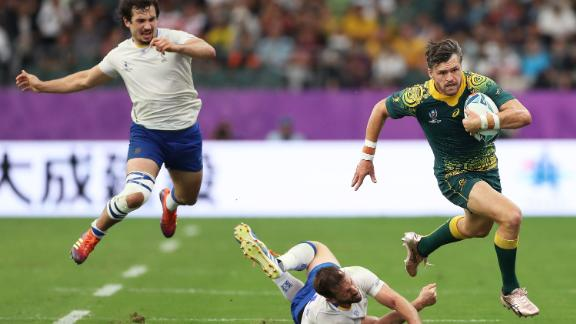 Adam Ashley-Cooper of Australia makes a break during his side's 45-10 win over Uruguay in Pool D at the Oita Stadium.