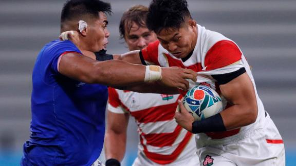 Japan's number 8 Kazuki Himeno (R) is tackled by Samoa's prop Michael Alaalatoa (L)  during a hard-fought encounter at the City of Toyota Stadium.