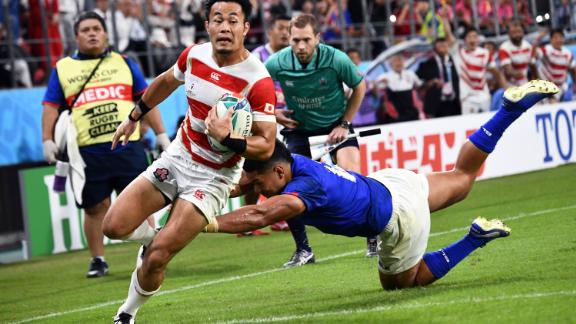 Japan's wing Kenki Fukuoka charges clear to score the third try for the Brave Blossoms.