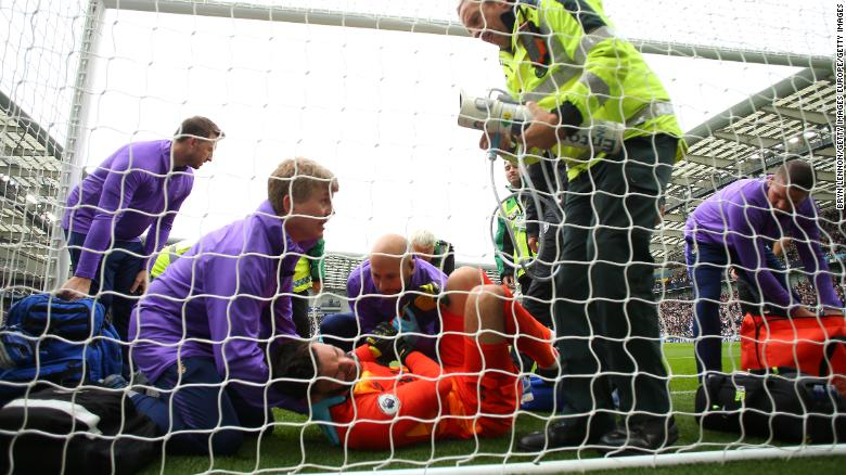 Hugo Lloris of Tottenham Hotspur receives medical treatment after his awkward fall that led to Brighton's first goal at the Amex Stadium.