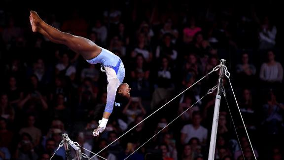 STUTTGART, GERMANY - OCTOBER 05: Simone Biles of USA performs on Uneven Bars during Women's Qualification on Day 2 of the FIG Artistic Gymnastics World Championships on October 05, 2019 in Stuttgart, Germany. (Photo by Laurence Griffiths/Getty Images)