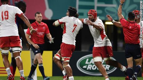 Tonga's flanker Zane Kapeli celebrates after scoring a his last-gasp try in the narrow 23-21 defeat to France in Kumamoto.